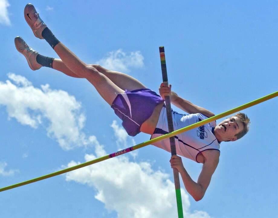 Midland High's Slade Harrell competes in the pole vault during the District 3-6A Track and Field Championships on Thursday, April 16, 2015, at Memorial Stadium. Harrell won the pole vault event with a height of 13 feet. James Durbin/Reporter-Telegram Photo: James Durbin