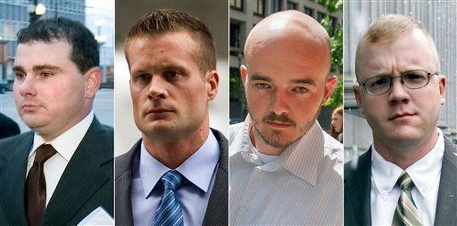 This combination made from file photo shows Blackwater guards, from left, Dustin Heard, Evan Liberty, Nicholas Slatten and Paul Slough. A years-long legal fight over a deadly mass shooting of civilians in an Iraq war zone reaches its reckoning point, when the former Blackwater security guards are sentenced for the rampage. Three of the guards, Heard, Liberty and Slough, face mandatory decades-long sentences because of firearms convictions. Slatten faces a penalty of life in prison after being found guilty of first-degree murder. (AP Photo) Photo: STF