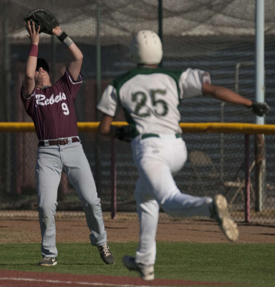 Lee High's Blake Blessie catches a pop foul for the out as El PAso Montwood's Sergio Gonzalez runs to first Friday afternoon at Christensen Stadium during the Tournament of Champions. Tim Fischer\Reporter-Telegram Photo: Tim Fischer