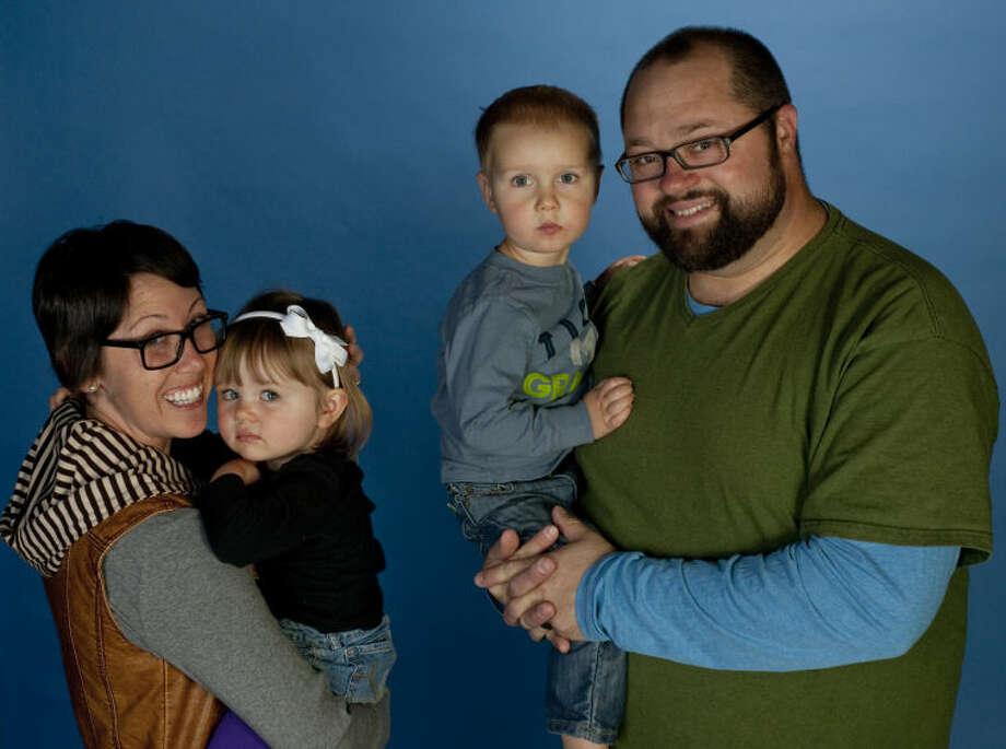 Sarah and Jon Stepan hold Elliott and Magnus. Tim Fischer\Reporter-Telegram Photo: Tim Fischer