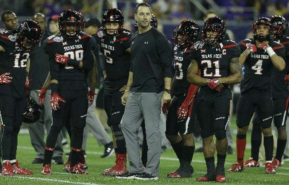 Texas Tech head coach Kliff Kingsbury watches his team warm up before the AdvoCare V100 Texas Bowl at NRG Stadium on Tuesday, Dec. 29, 2015, in Houston. ( Brett Coomer / Houston Chronicle )