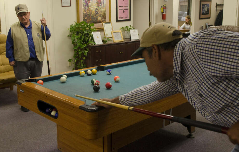 Senior Companion volunteer John Martin, left, waits for his shot as he plays Mario Calderon in this MRT file photo. Photo by Tim Fischer/Midland Reporter-Telegram Photo: Tim Fischer