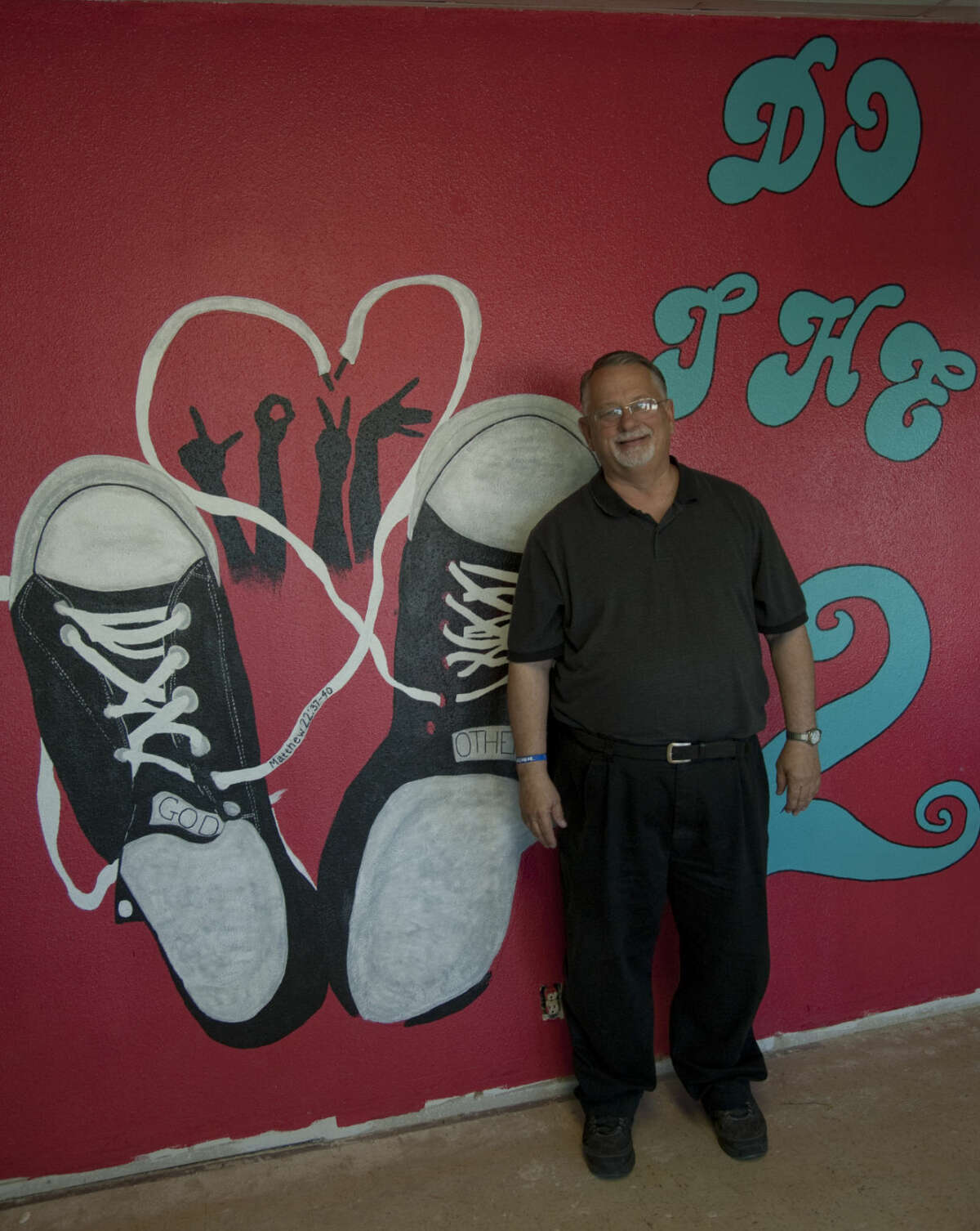 Pastor Scott Sheppard, with One Hope Church of Christ, shows some of the artwork done by parishioners in the education wing as renovations continue in the new buildings. Thursday, 4-16-15 Tim Fischer\Reporter-Telegram