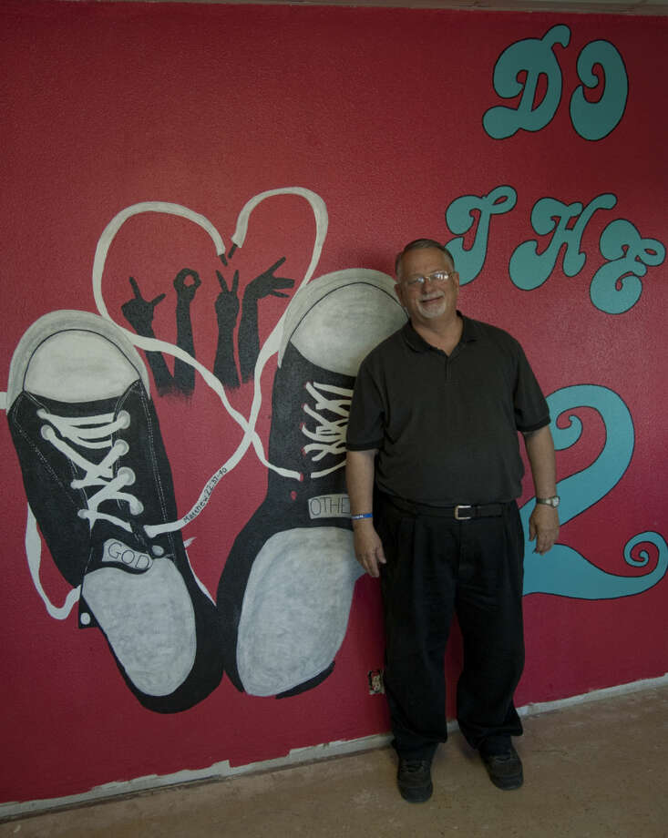 Pastor Scott Sheppard, with One Hope Church of Christ, shows some of the artwork done by parishioners in the education wing as renovations continue in the new buildings. Thursday, 4-16-15 Tim Fischer\Reporter-Telegram Photo: Tim Fischer