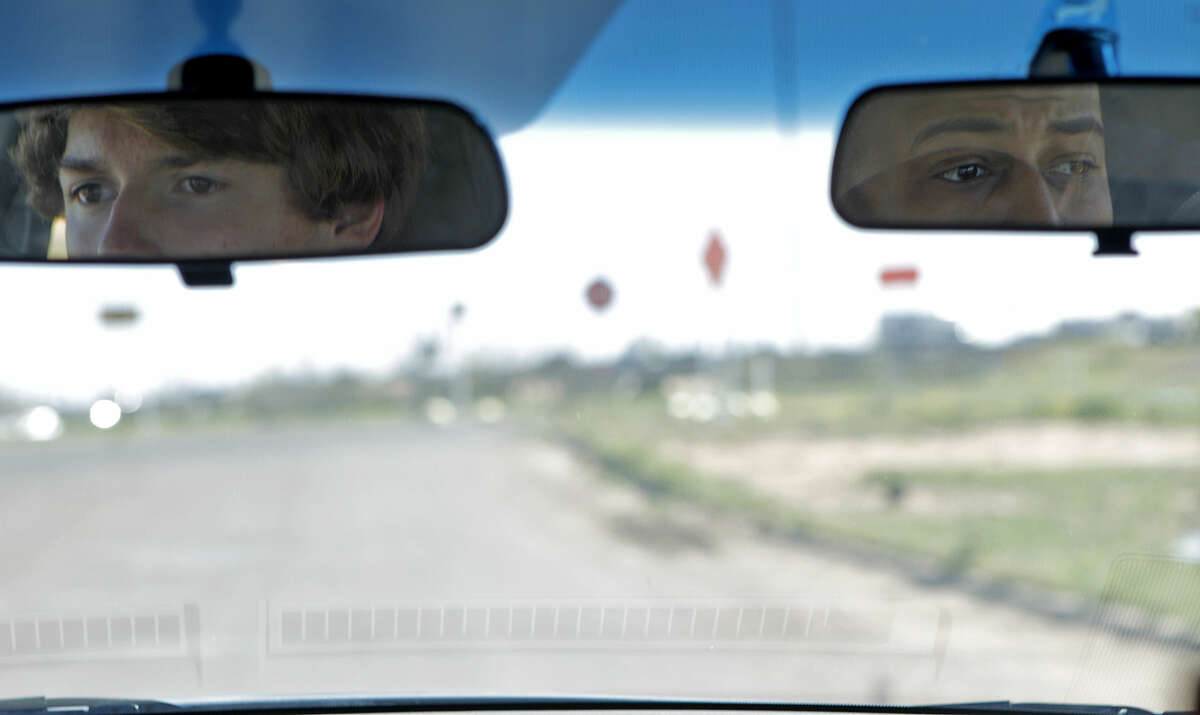 Shane Aaron, a sophomore at Midland High (left), hits the streets under the supervision of Coach Ned Simmons (right) of Big C's Drivers Ed on Wednesday, April 15, 2015. James Durbin/Reporter-Telegram