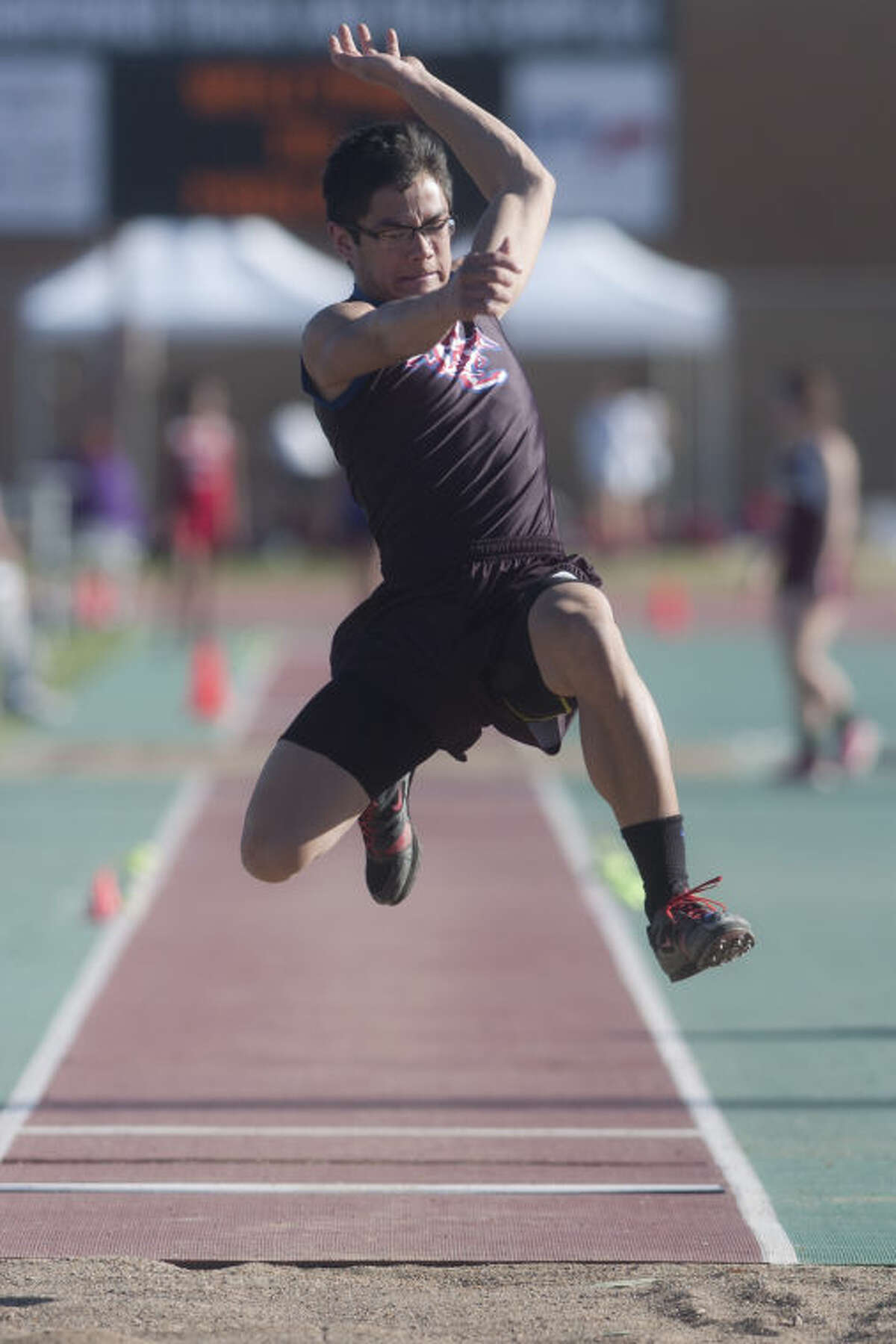 Midland Christian's Devin Nguyen competes in the long jump event during the Rogers Lincoln Ford Tall City Invitational on Friday at Memorial Stadium. James Durbin/Reporter-Telegram