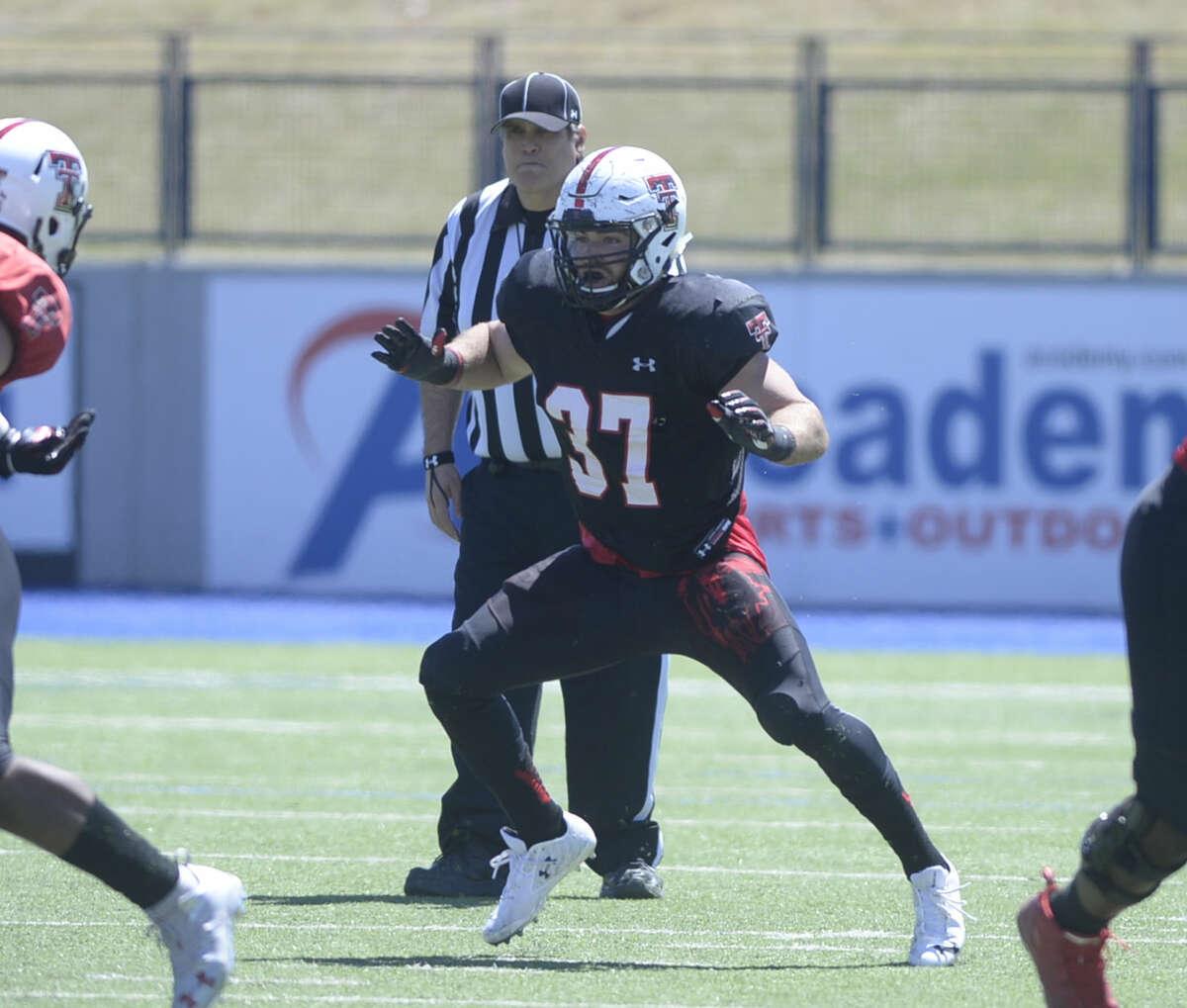 Texas Tech linebacker Luke Stice, a Lee High graduate, runs plays during the spring scrimmage Saturday, April 2, 2016, at Grande Communications Stadium. James Durbin/Reporter-Telegram