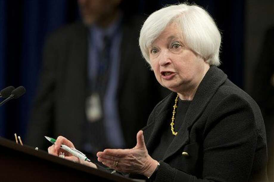 Federal Reserve Chair Janet Yellen gestures as she answers a question during a news conference in Washington, Thursday, Sept. 17, 2015. The Federal Reserve is keeping U.S. interest rates at record lows in the face of threats from a weak global economy, persistently low inflation, and unstable financial markets. (AP Photo/Jacquelyn Martin)