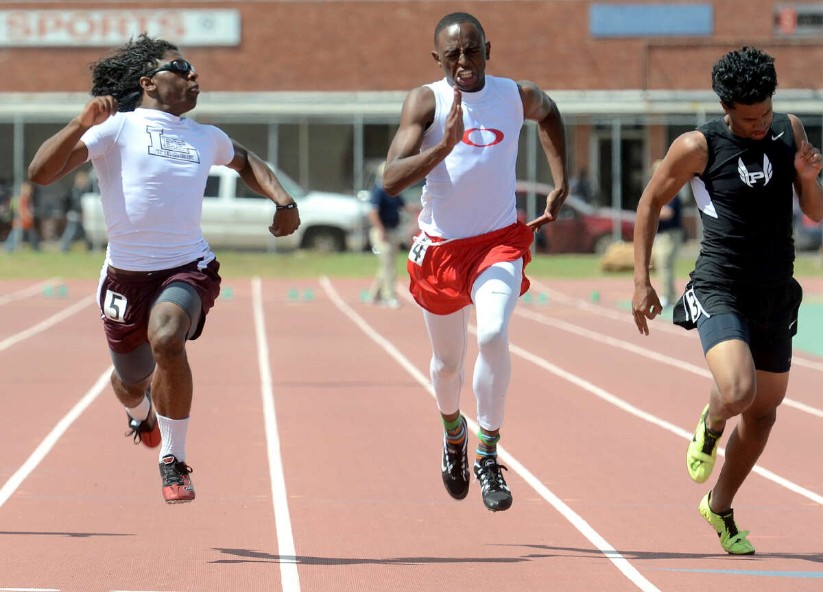 Lee High's Terry Sims peeks at his competitors as he crosses the finish line in the 100 meter dash during the District 3-6A Track and Field Championships on Friday, April 17, 2015 at Memorial Stadium. James Durbin/Reporter-Telegram