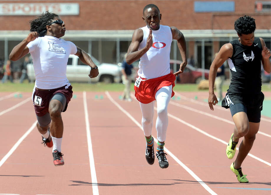 Lee High's Terry Sims peeks at his competitors as he crosses the finish line in the 100 meter dash during the District 3-6A Track and Field Championships on Friday, April 17, 2015 at Memorial Stadium. James Durbin/Reporter-Telegram Photo: James Durbin