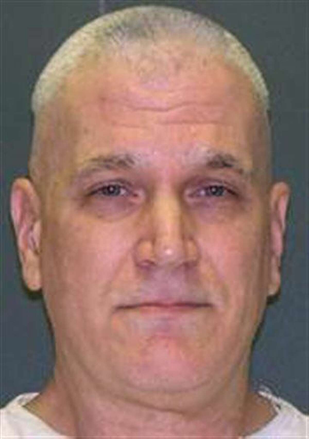 This undated handout photo provided by the Texas Department of Criminal Justice shows John David Battaglia. Enraged over his ex-wife going to police about his repeated harassment and likely arrest, Battaglia used a May 2001 visit with their two young daughters to avenge his anger. As their mother helplessly listened on the phone to one of the girls' cries, he fatally shot them both at his Dallas apartment. On Wednesday, March 30, 2016, Battaglia is set for lethal injection for the slayings. (Texas Department of Criminal Justice via AP)