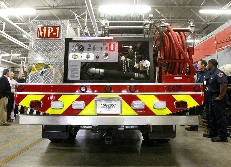 Concho Resources donated a mini-pumper fire truck to the Midland Fire Department during a ceremony Tuesday, March 31, 2015, at the Central Fire Station. James Durbin/Reporter-Telegram Photo: James Durbin