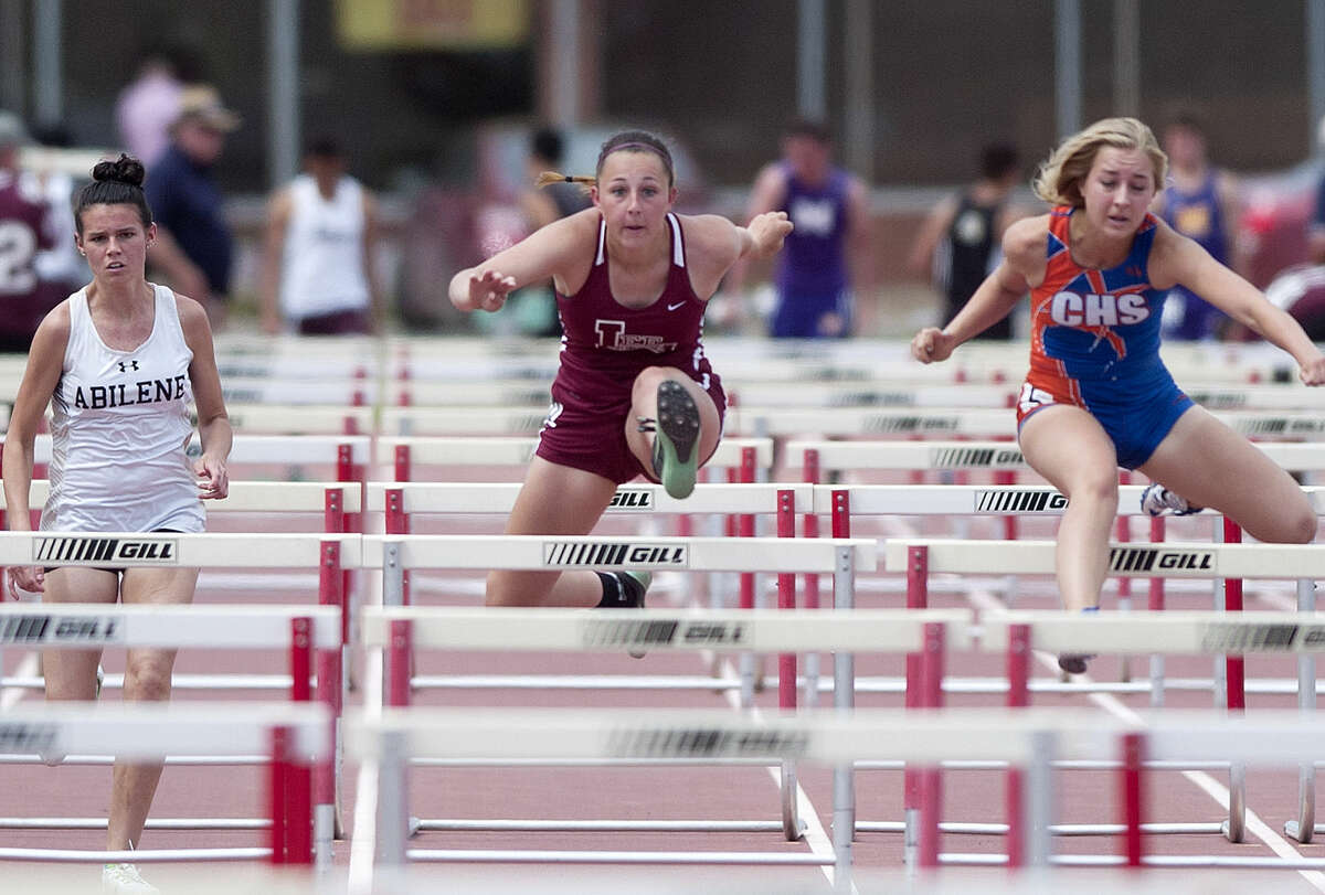 Ashley Rackow competes in the 100 hurdle during the District 3-6A Track and Field Championships on Friday, April 17, 2015 at Memorial Stadium. James Durbin/Reporter-Telegram