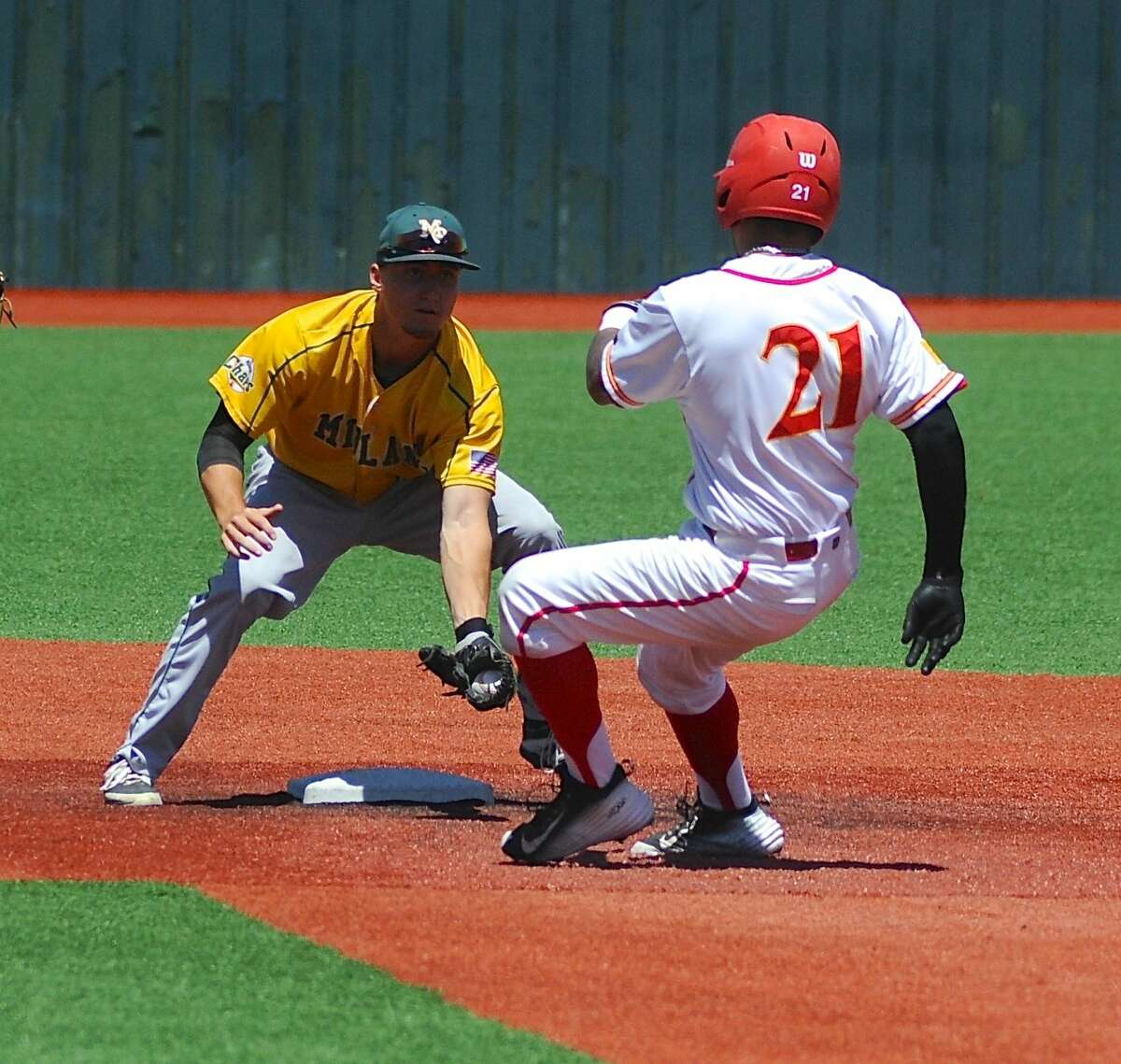 Midland College second baseman Chris Thibideau tags out New Mexico Junior College's Angel Vega in the first game of a doubleheader in Hobbs, N.M. Clayton Jones/Hobbs News-Sun