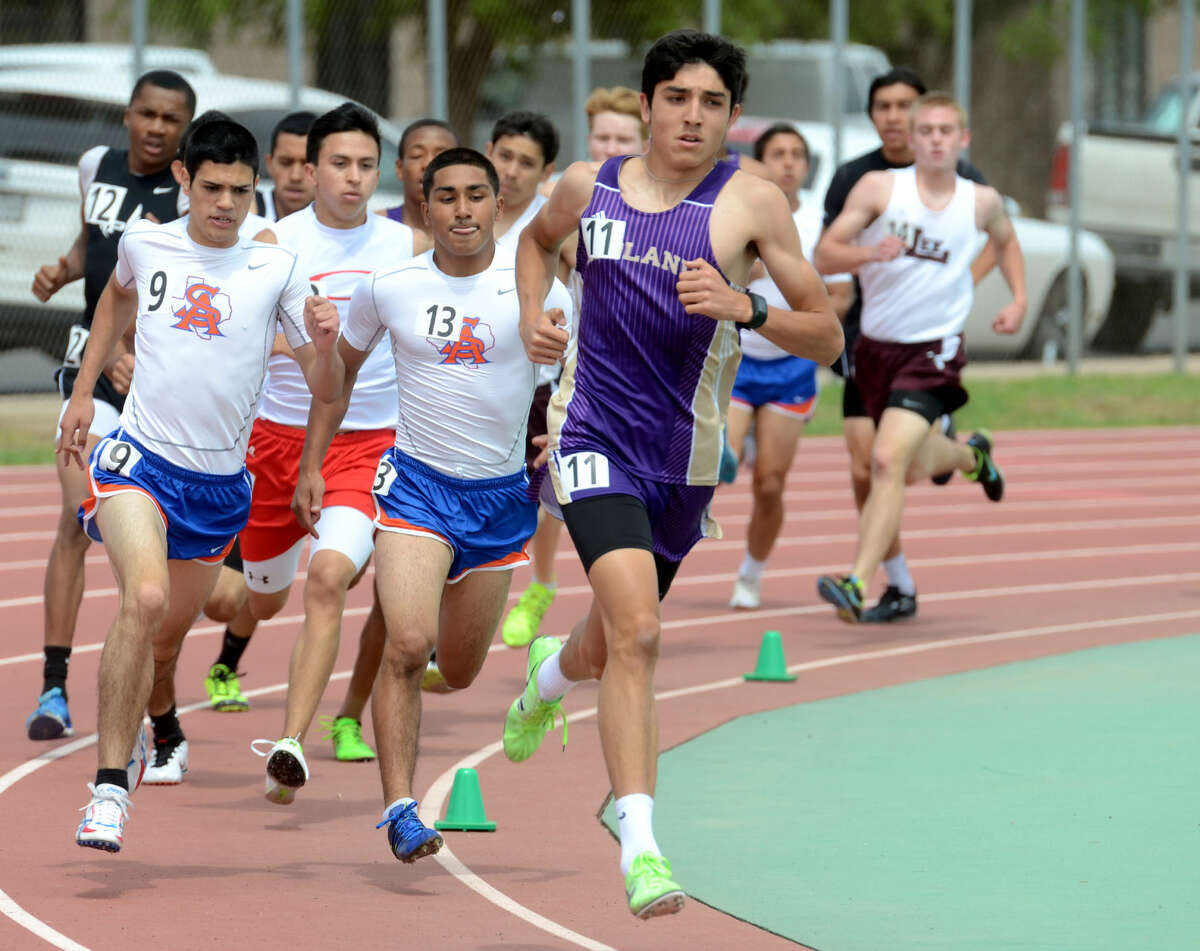 Bryce Hoppel leads the pack in the 800 during the District 3-6A Track and Field Championships on Friday, April 17, 2015 at Memorial Stadium. James Durbin/Reporter-Telegram