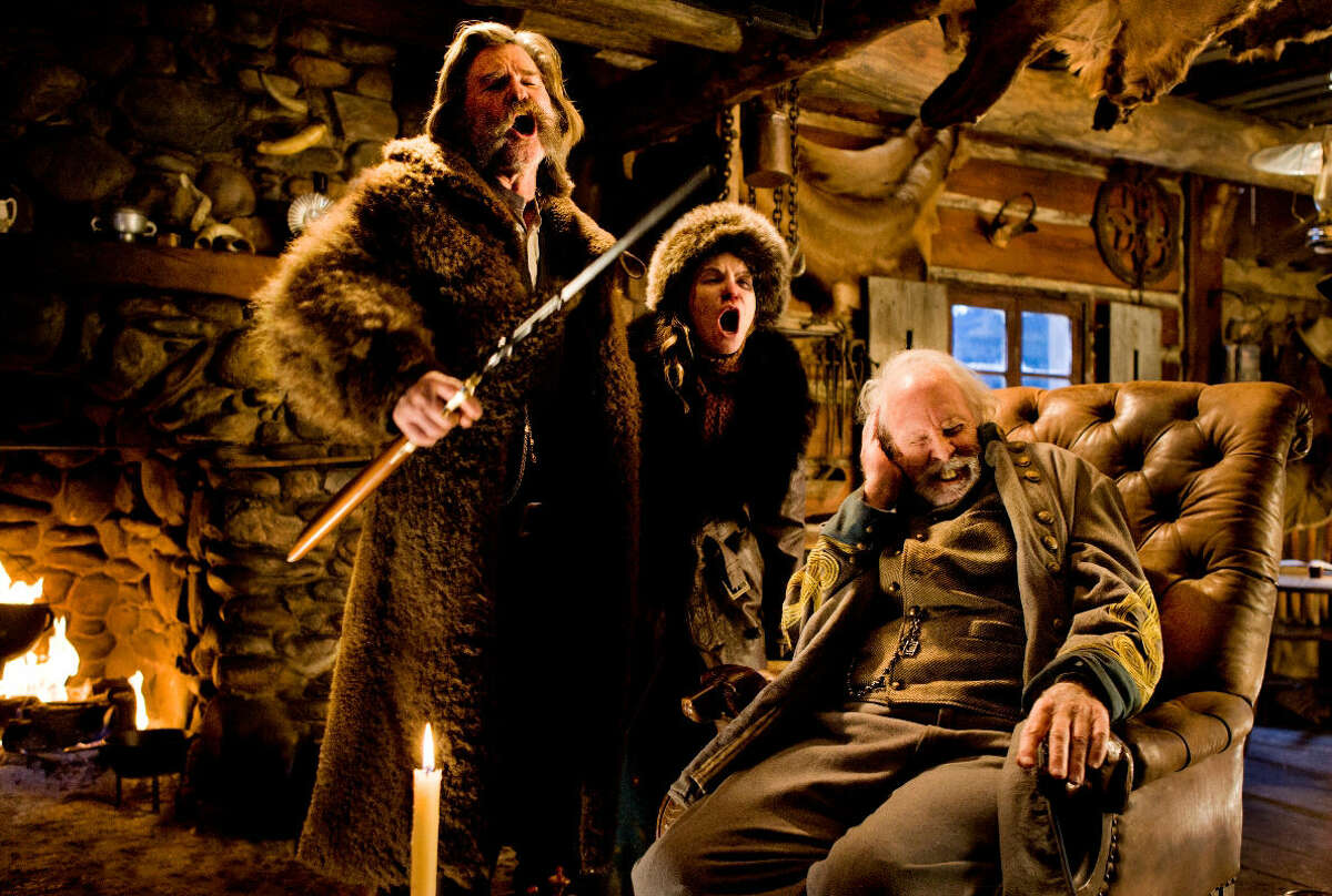"""This image released by The Weinstein Company shows Kurt Russell, from left, Jennifer Jason Leigh and Bruce Dern in a scene from the film, """"The Hateful Eight."""" (Andrew Cooper/The Weinstein Company via AP)"""