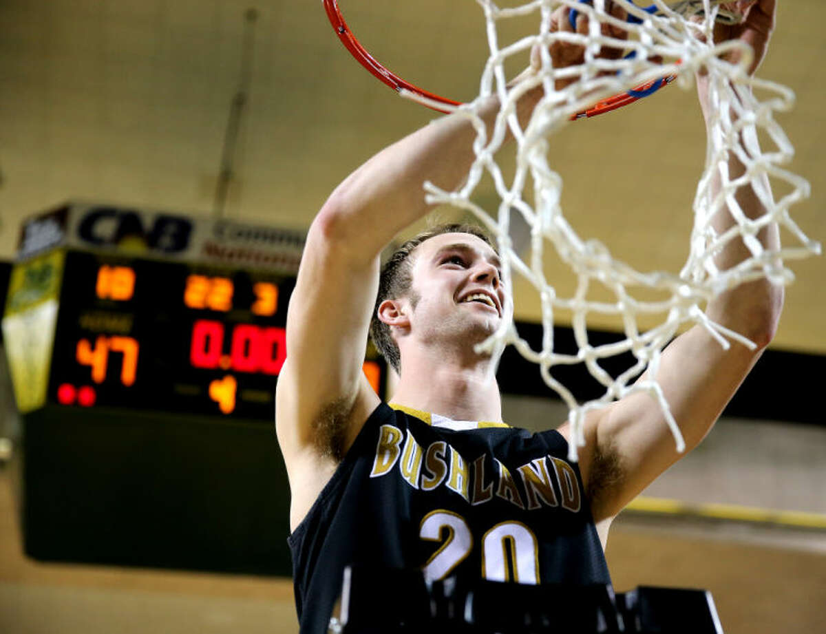 Bushland's Bayler Andrews takes his turn at cutting down the net after the Falcon's victory Saturday afternoon in the UIL Region 1-2A final Saturday at the Chaparral Center.