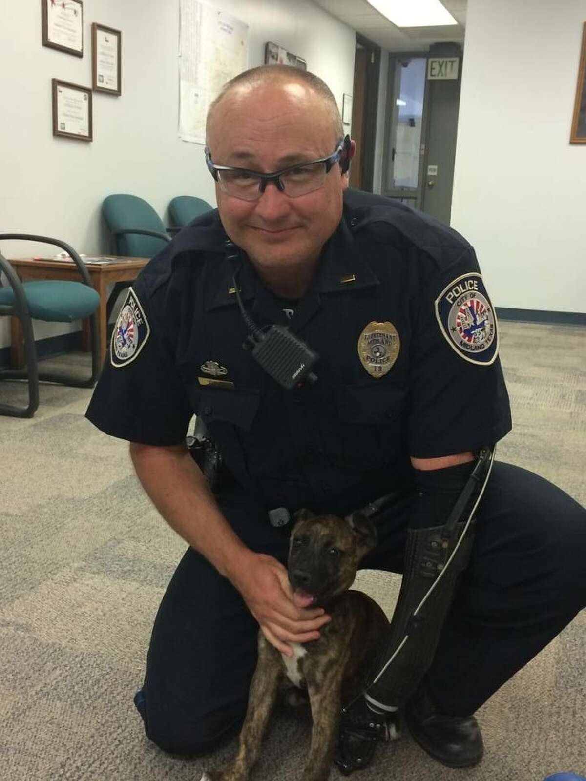 Midland Police Department Lt. Brian Rackow officially adopted the puppy, named Marley, on Tuesday.
