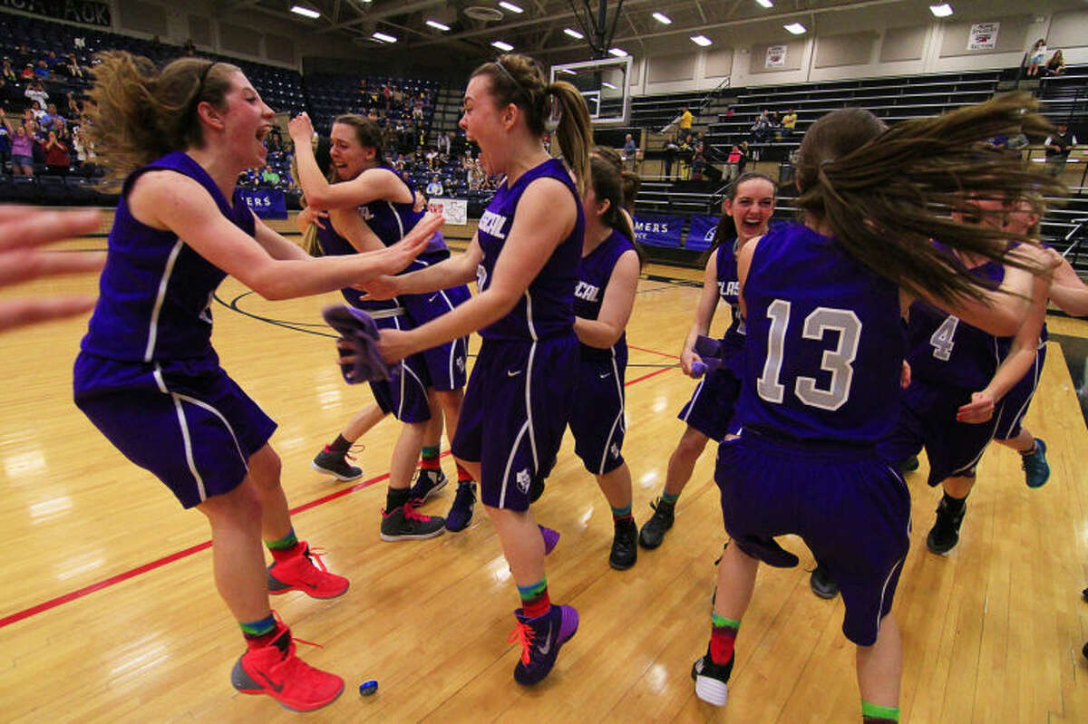Midland Classical celebrates its victory during a TAPPS 3A Championship girls basketball game against Austin Brentwood at Legacy High School in Mansfield, TX on Saturday. (Photo by Ray Carlin)