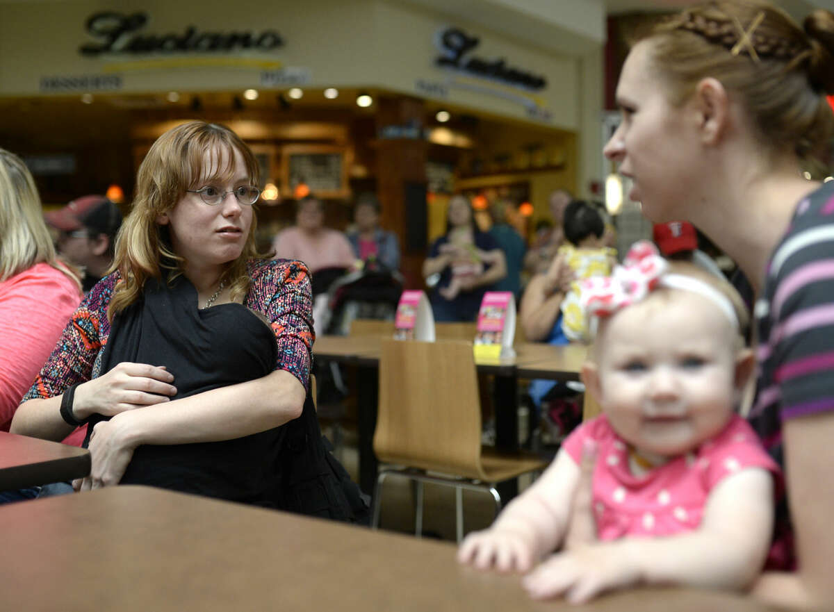 Jennifer Cronic feeds her 2-month-old son Henry during a sit-in breastfeeding session Saturday, March 26, 2016, at Midland Park Mall. James Durbin/Reporter-Telegram