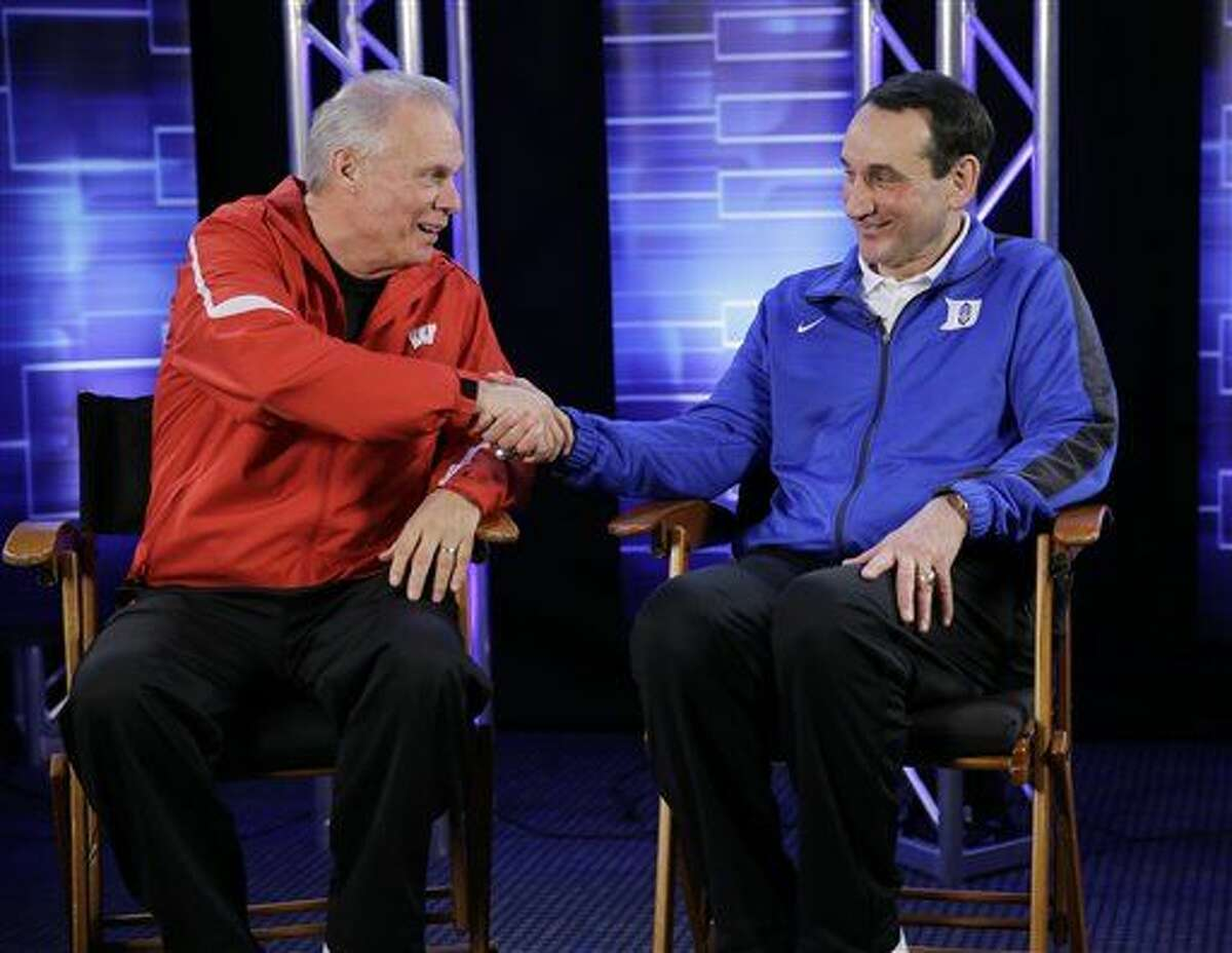 Wisconsin head coach Bo Ryan and Duke head coach Mike Krzyzewski shake hands during a CBS Sports interview for the NCAA Final Four college basketball tournament championship game Sunday, April 5, 2015, in Indianapolis. AP Photo/David J. Phillip