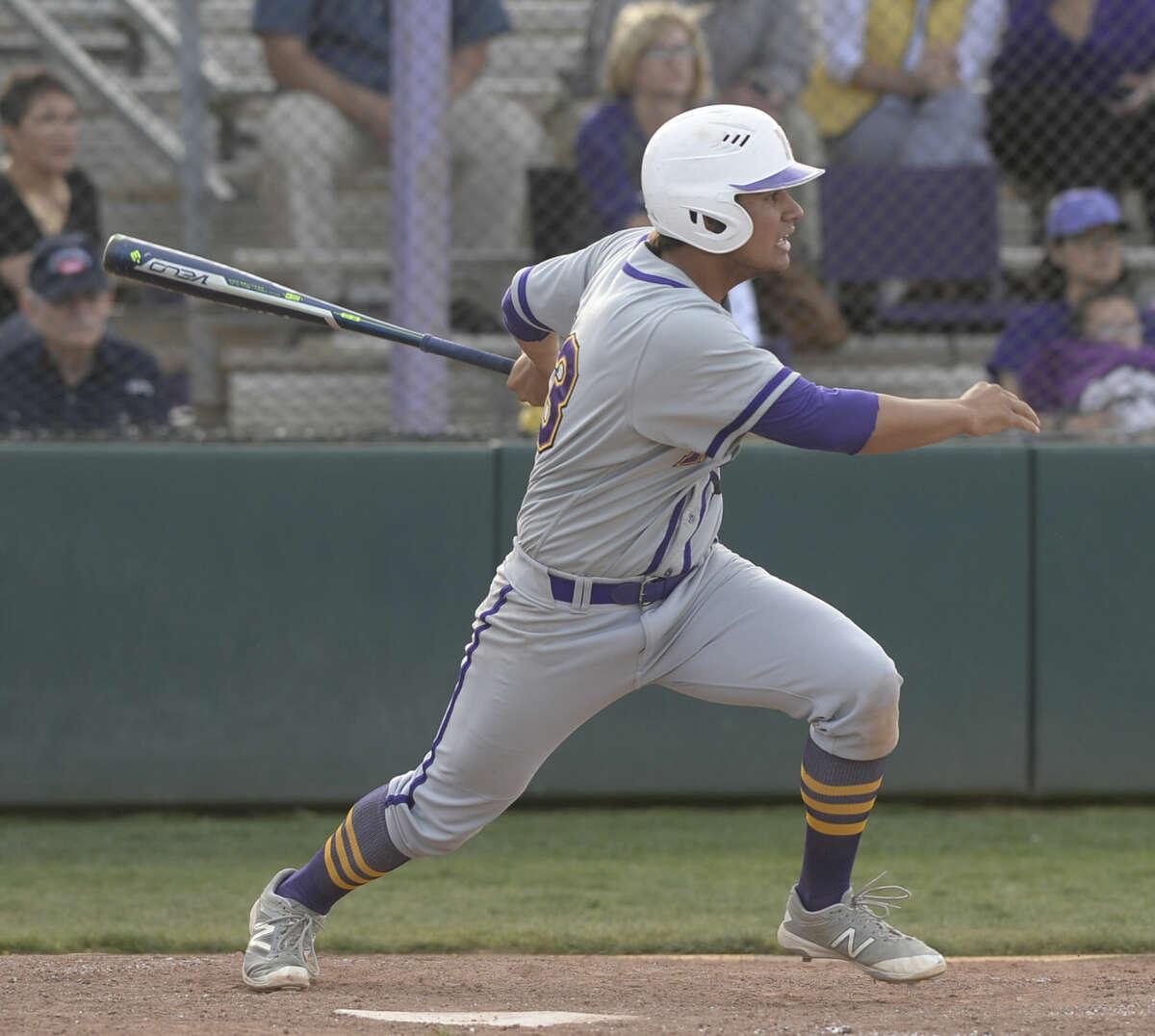 Midland High's Jacob Mata (13) hits against San Angelo on Tuesday, March 22, 2016, at Zachery Field. James Durbin/Reporter-Telegram