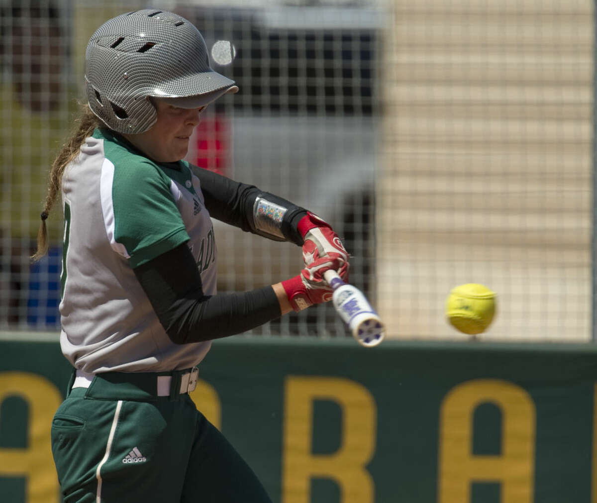 Midland College's Danica Ferrisco connects for a hit Monday 03-28-16 against Western Texas. Tim Fischer\Reporter-Telegram