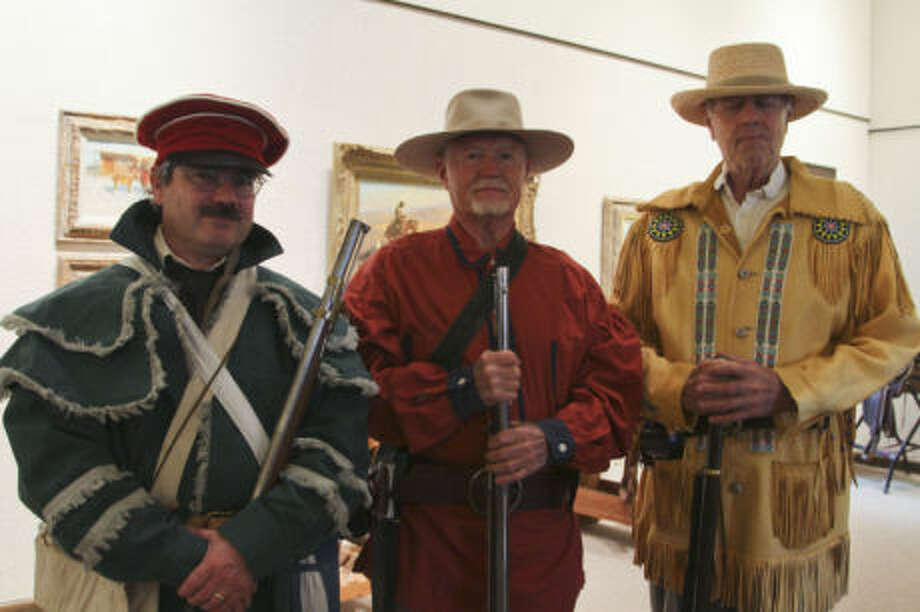 From left: Ralph White, Tex Paris and Tom Owens participated in a three-musket salute Sunday during the Haley Library's observance of Texas Independence Day. Tyler White/Reporter-Telegram Photo: Tyler White