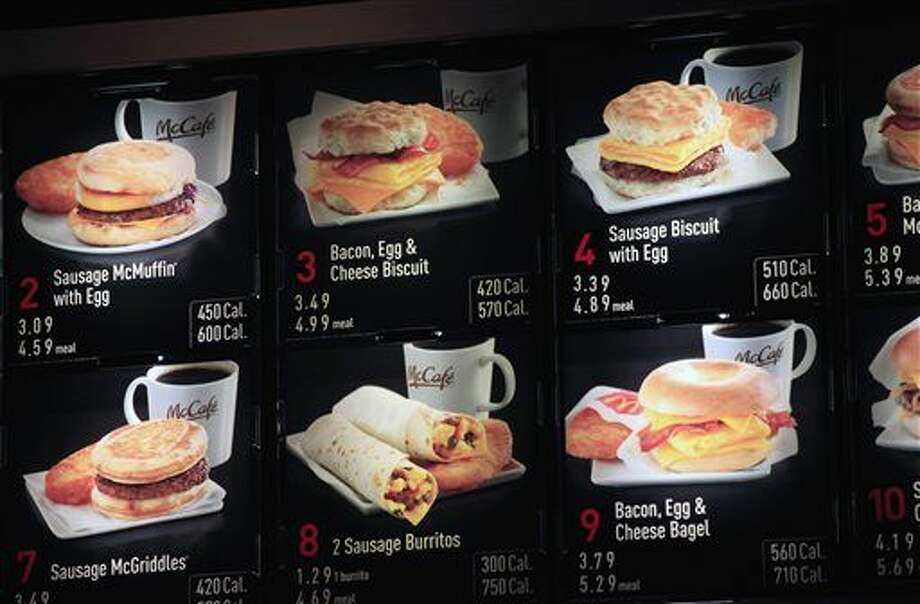FILE - In this Sept. 12, 2012 file photo, items on the breakfast menu, including the calories, are posted at a McDonald's restaurant in New York. Wondering how many calories are in that hamburger? Chain restaurants still don't have to tell you, despite a six year-old law requiring calorie labels. The Food and Drug Administration said earlier this month that it will delay menu labeling rules, again, until next year. Pushback from supermarkets and convenience stores that will be required to put calorie labels on take-out foods have slowed the process. (AP Photo/Mark Lennihan, File) Photo: Mark Lennihan