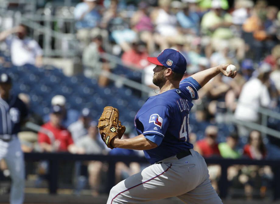 Texas Rangers' Colby Lewis throws during a inning of a spring training baseball game against the San Diego Padres, Tuesday, March 22, 2016, in Peoria, Ariz. (AP Photo/Darron Cummings) Photo: Darron Cummings