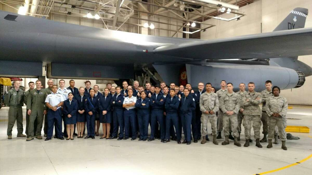 Picture of the cadets with a B-1 Lancer with the flight crew on the viewers left and the maintainers on the right.