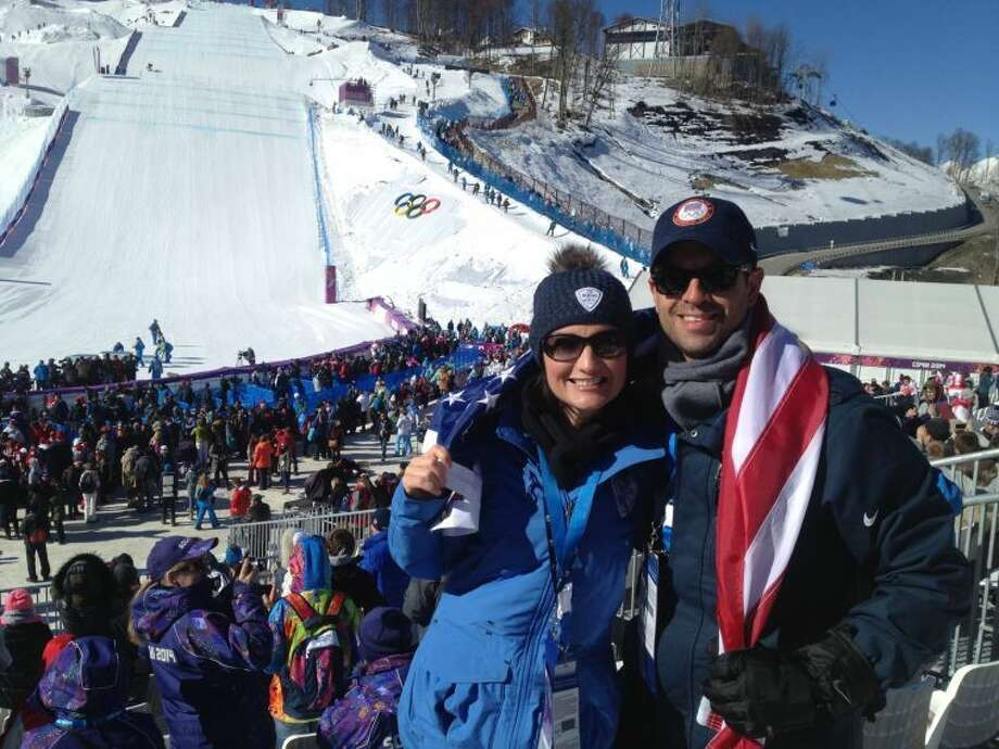 Crystal and John Valletta traveled from Midland to watch the 2014 Winter Olympics in Sochi, Russia. They were sponsored by BMW of North America. John is the general manager at BMW of the Permian Basin. The couple are seen in front of the slopestyle snowboarding track. Photo: Courtesy Photo