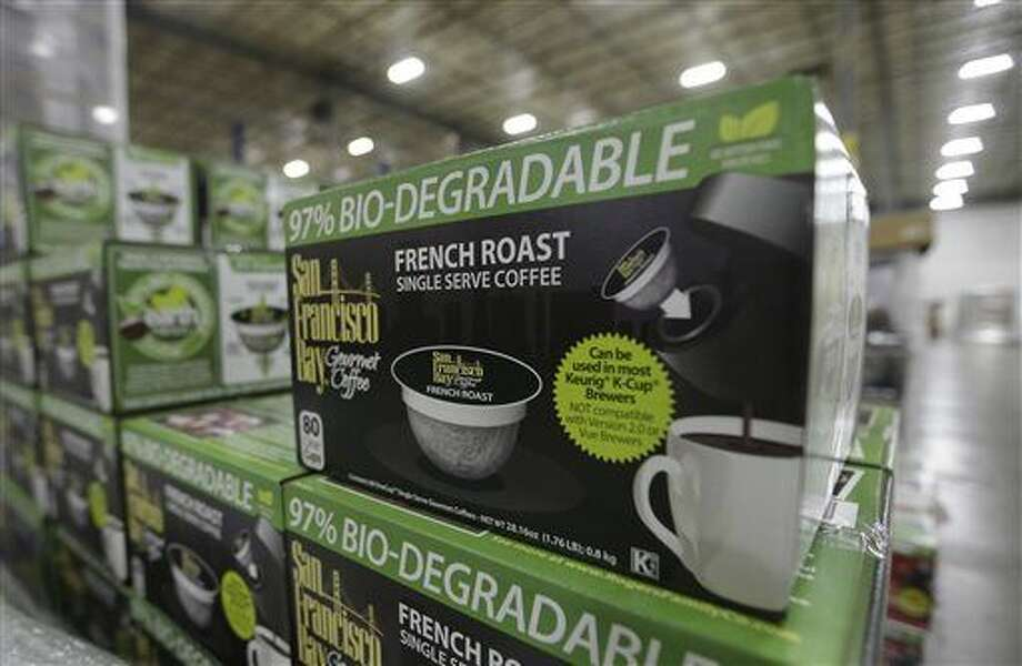 In this photo taken Wednesday, March 4, 2015, packaged coffee pods highlighting the biodegradability of it's product, are stacked for shipment from the Rogers Family Company in Lincoln, Calif. The Rogers company is one of several coffee roasters who make single-serve coffee pods for use in the Keurig Green Mountain's single- serve coffee machines. The Rogers company is one of more than a dozen-coffee-makers and other businesses suing Keurig over what they claim is Keurig's unfair trade efforts to shut out competing single-serve coffee rivals.(AP Photo/Rich Pedroncelli) Photo: Rich Pedroncelli