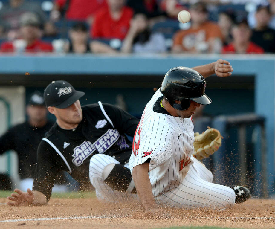 Texas Tech's Eric Gutierrez (12) slides home to score against Abilene Christian pitcher Nate Cole (34) on Tuesday, April 21, 2015, at Security Bank Ballpark. James Durbin/Reporter-Telegram Photo: James Durbin