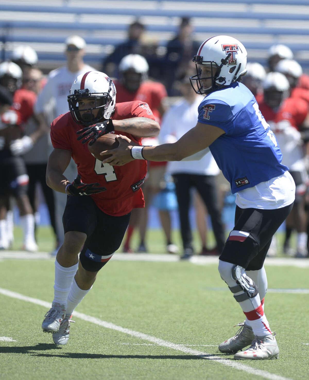 Texas Tech quarterback Patrick Mahomes II (5) hands off to running back Justin Stockton (4) during spring scrimmage Saturday, April 2, 2016, at Grande Communications Stadium. James Durbin/Reporter-Telegram