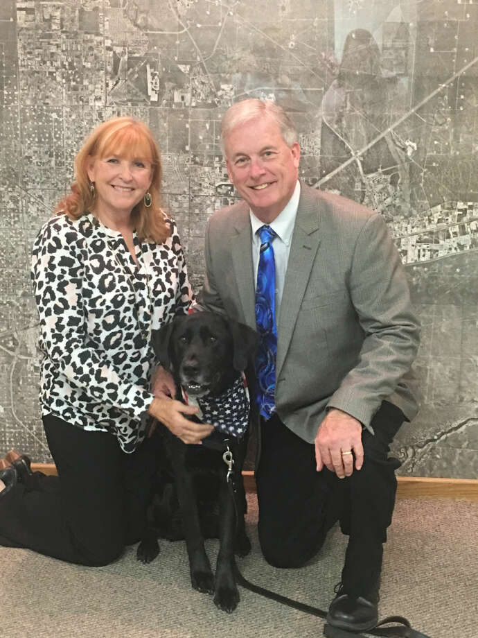 Steve Loving, vice president of corporate business development at Core Laboratories in Houston and chairman of the Faces of Freedom Clay tournament, and his wife, Cherilyn Loving, visited Midland and Odessa last week with Cargo, one of the dogs with Freedom Service Dogs. Photo: Courtesy Photo