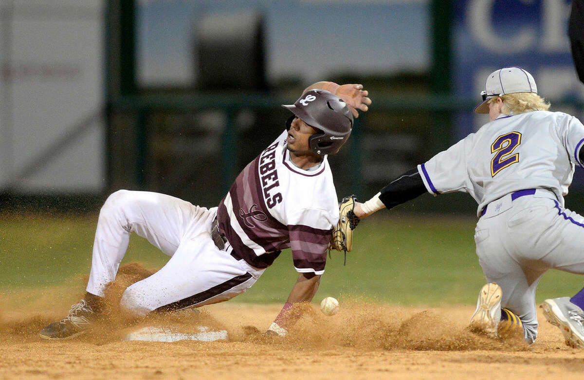 Lee's Tailan Boza (17) beats the tag at second base from Midland's Luke Edmondson (2) on Thursday, March 3, 2016 in the Tournament of Champions at Security Bank Ballpark. James Durbin/Reporter-Telegram