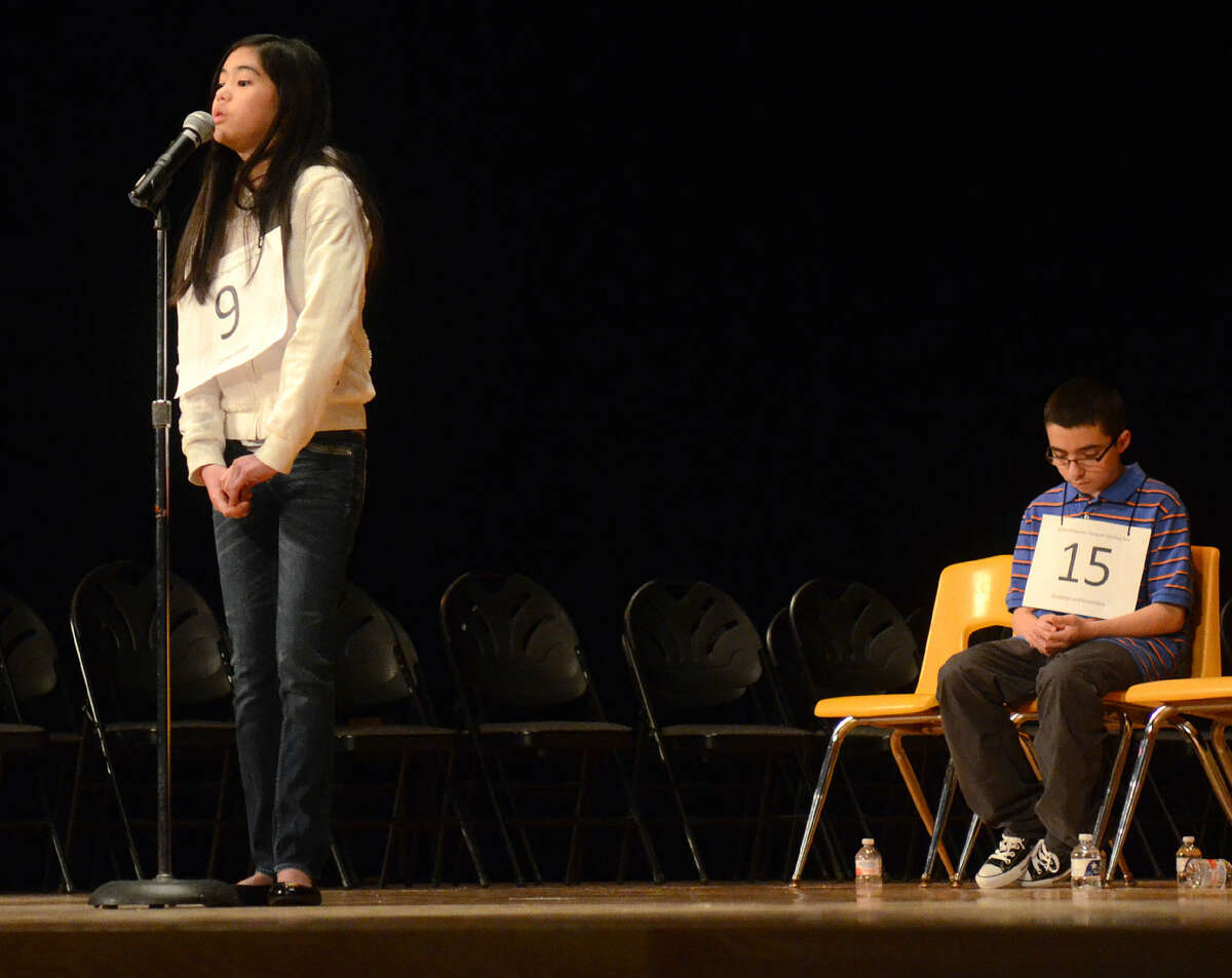 Anna Ngo of Carver competes in the Midland Reporter-Telegram regional spelling bee on March 21. Anna is among 285 contestants in the Scripps National Spelling Bee. Preliminary rounds are Wednesday. Semifinals and finals are Thursday.