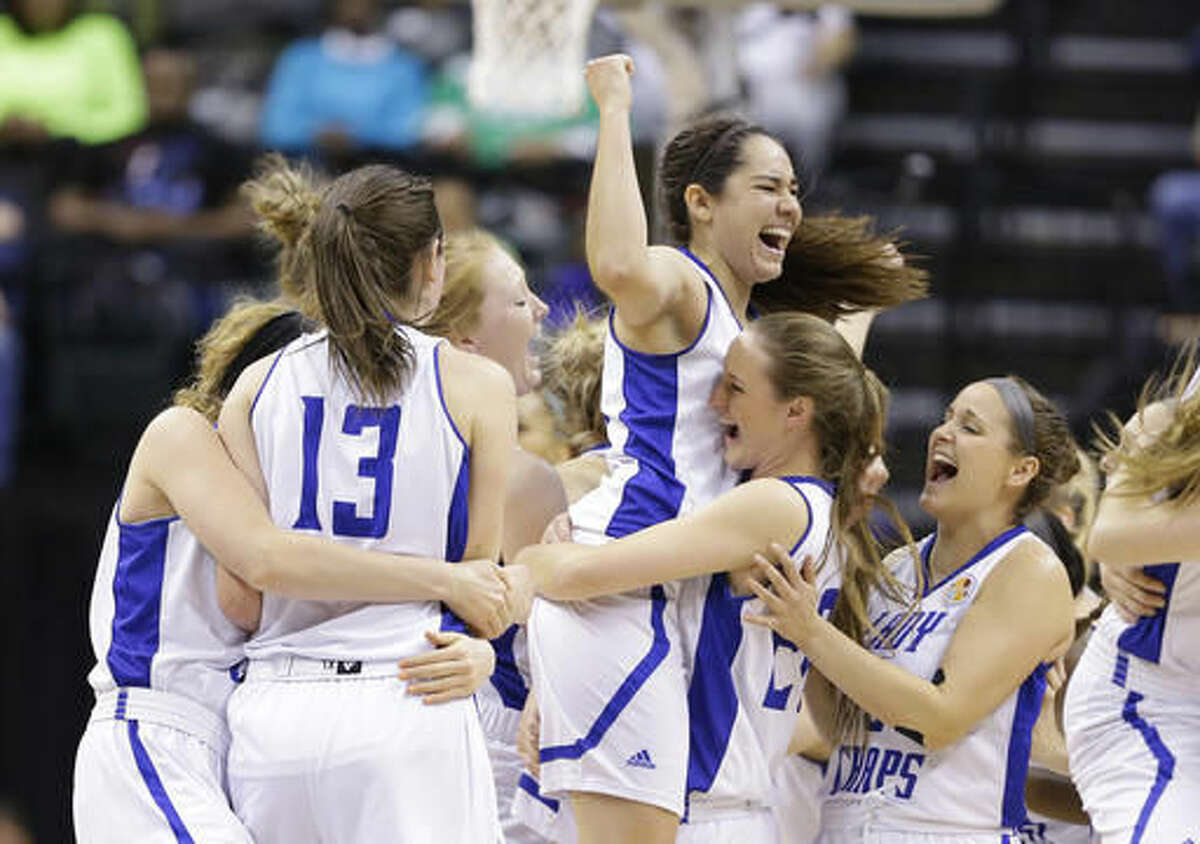 Lubbock Christian's Kelsey Hoppel celebrates with teammates after they defeated Alaska Anchorage to win the championship game at the women's NCAA Division II basketball tournament Monday, April 4, 2016, in Indianapolis. (AP Photo/Michael Conroy)