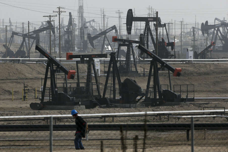 Pumpjacks operate at the Kern River Oil Field, Friday, Jan. 16, 2015, in Bakersfield, Calif. California regulators authorized oil companies more than 2,500 times to inject wastewater and other production-related fluids into federally protected aquifers potentially suitable for drinking and watering crops in the nation's agricultural center, state records show. (AP Photo/Jae C. Hong) Photo: Jae C. Hong