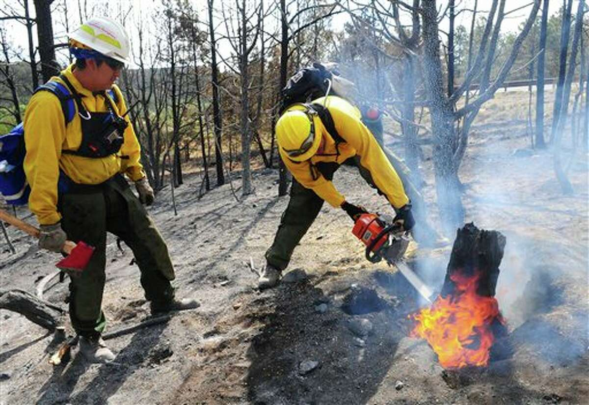 A picture from a previous wildfire in 2012 (AP Photo/Albuquerque Journal, Adolphe Pierre-Louis)