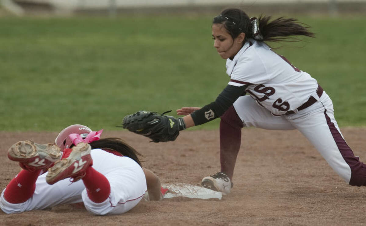 Lee High's Gaby Hernandez tries to put the tag on Odessa High's #3 after she overran the base Tuesday afternoon at Gene Smith Field. Tim Fischer\Reporter-Telegram
