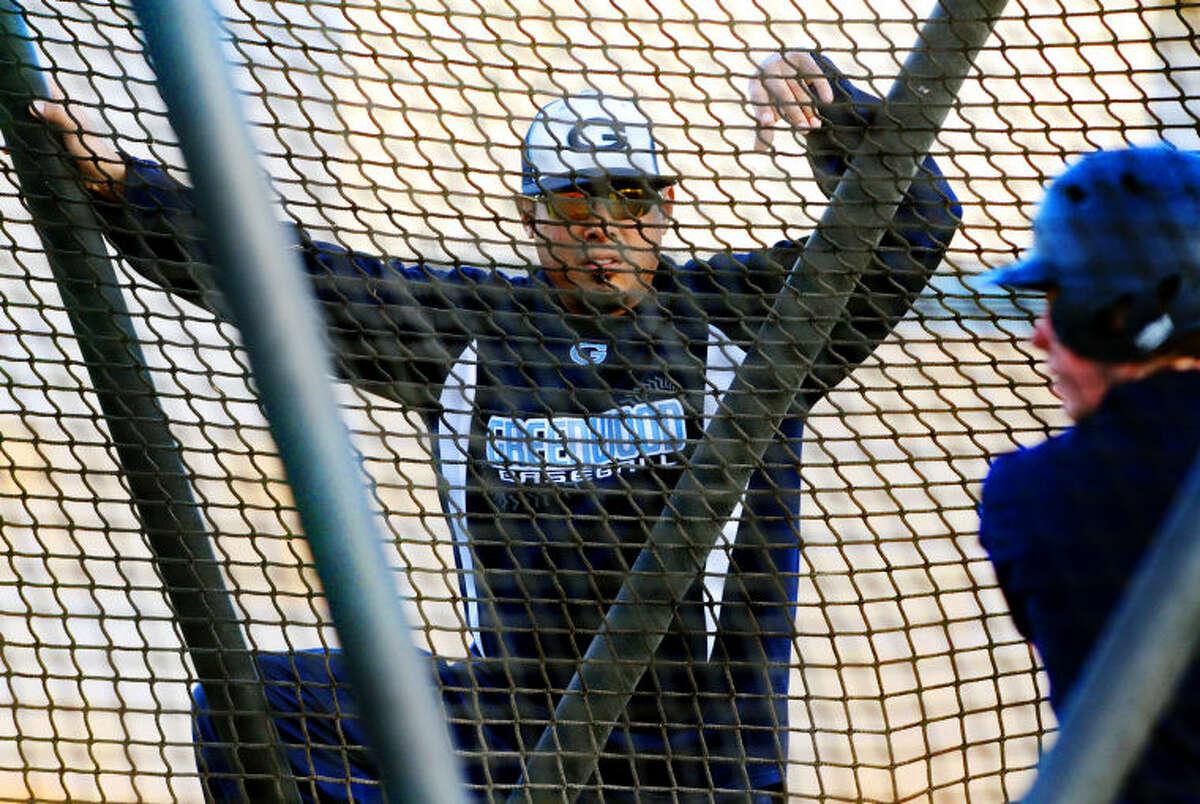 New Greenwood boys baseball coach Stephen Rodriguez looks on during team practice Wednesday at Greenwood High. James Durbin/Reporter-Telegram