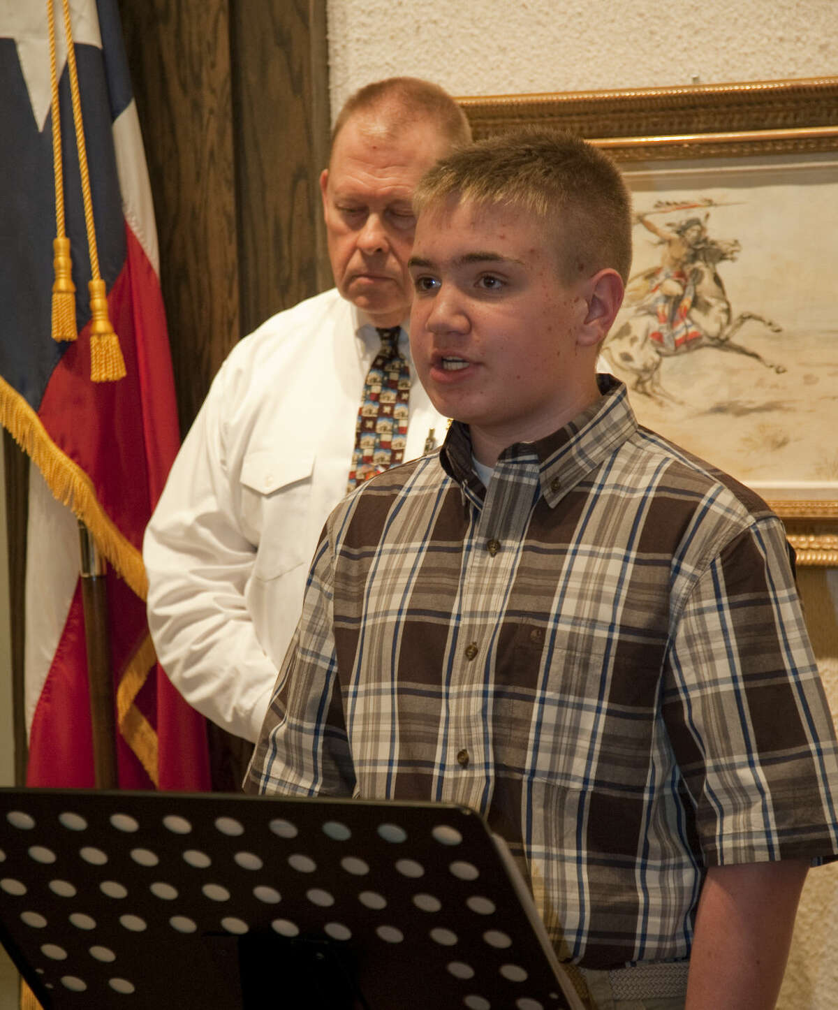 Tyler Wilson, seventh grader at Midland Christian, reads his winning esssay