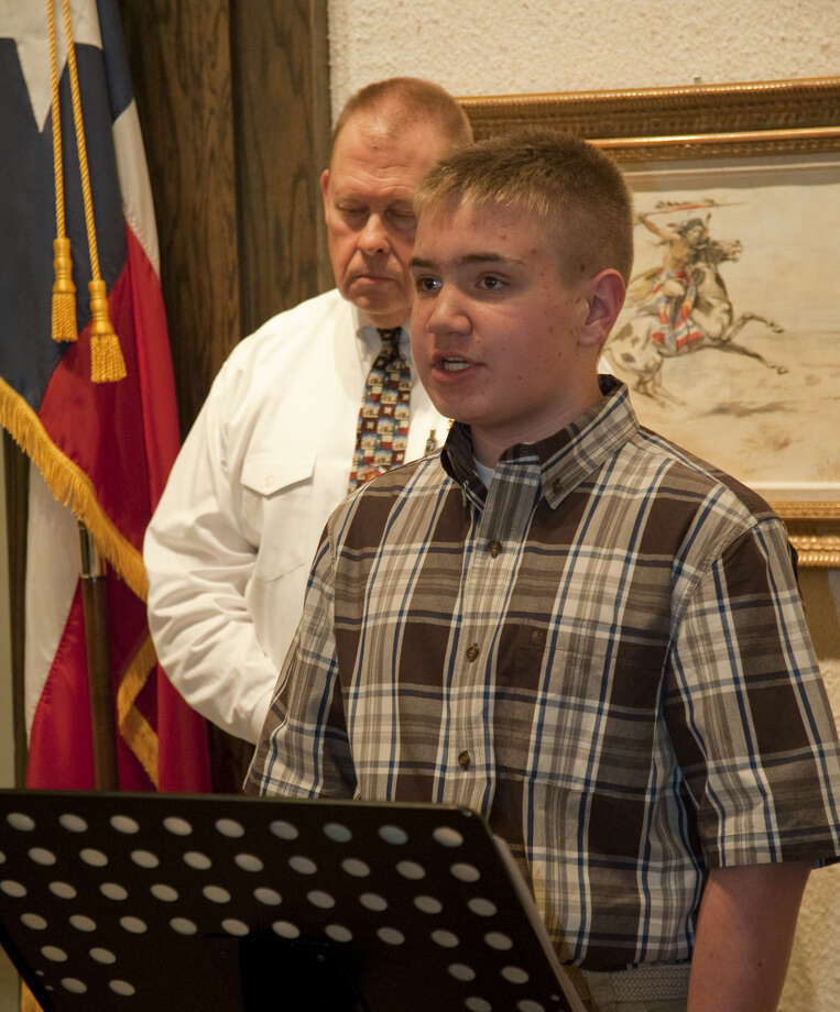 "Tyler Wilson, seventh grader at Midland Christian, reads his winning esssay ""I am Jim Bowie"" during the Texas Independence Day celebration Monday, 3-2-15, at the Haley Library. Tim Fischer\Reporter-Telegram Photo: Tim Fischer"
