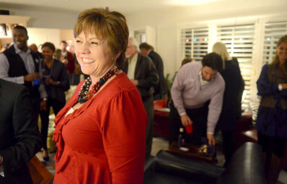 Karen Hood, tax assessor collector, celebrates during an election watch party Tuesday at County Judge Mike Bradford's house. James Durbin/Reporter-Telegram Photo: JAMES DURBIN