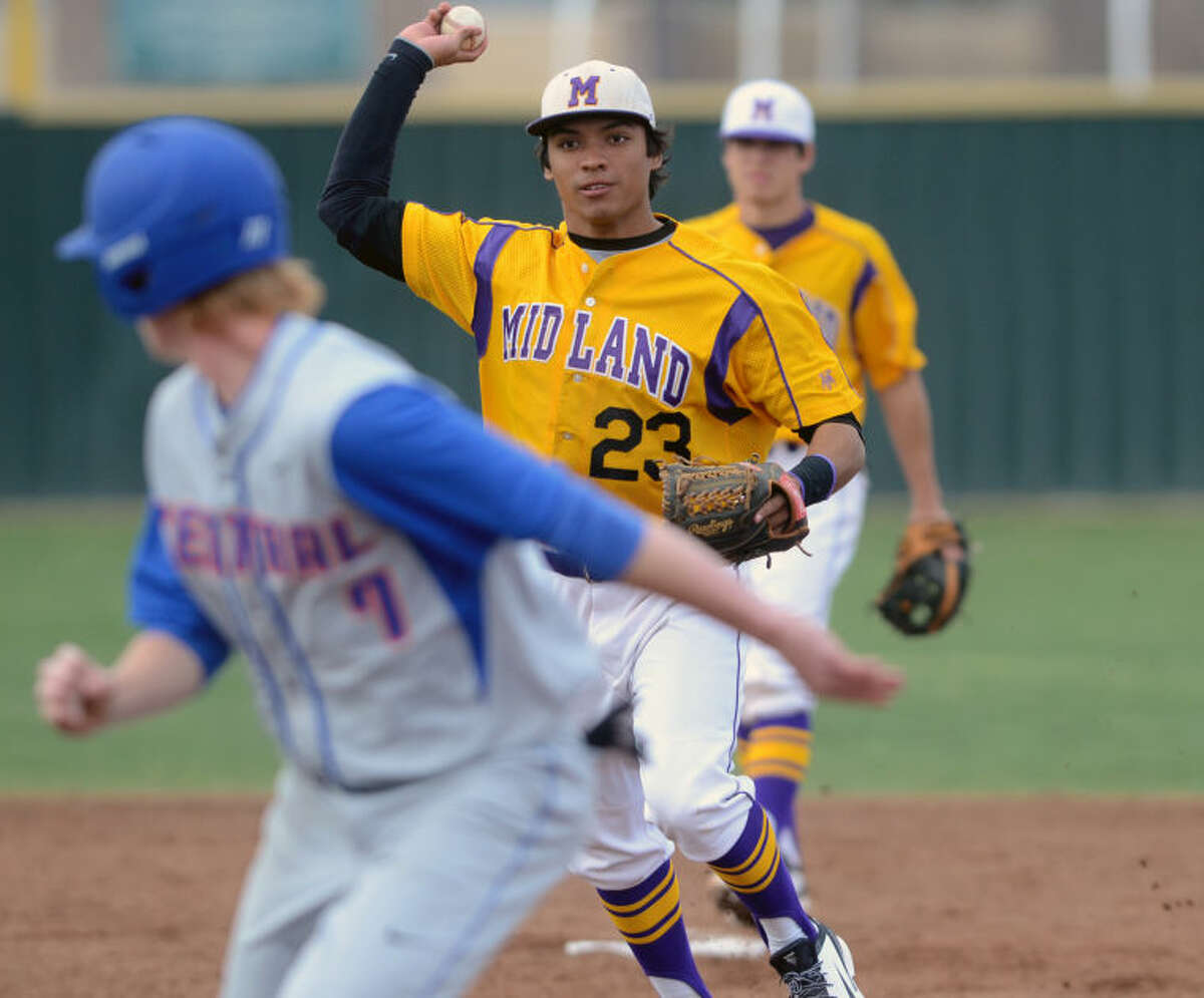 Midland High's Gilbert Sanchez throws to first base over San Angelo Central's trapped baserunner Clay Wegner during the game against San Angelo Central's on Tuesday at Zachery Field. James Durbin/Reporter-Telegram