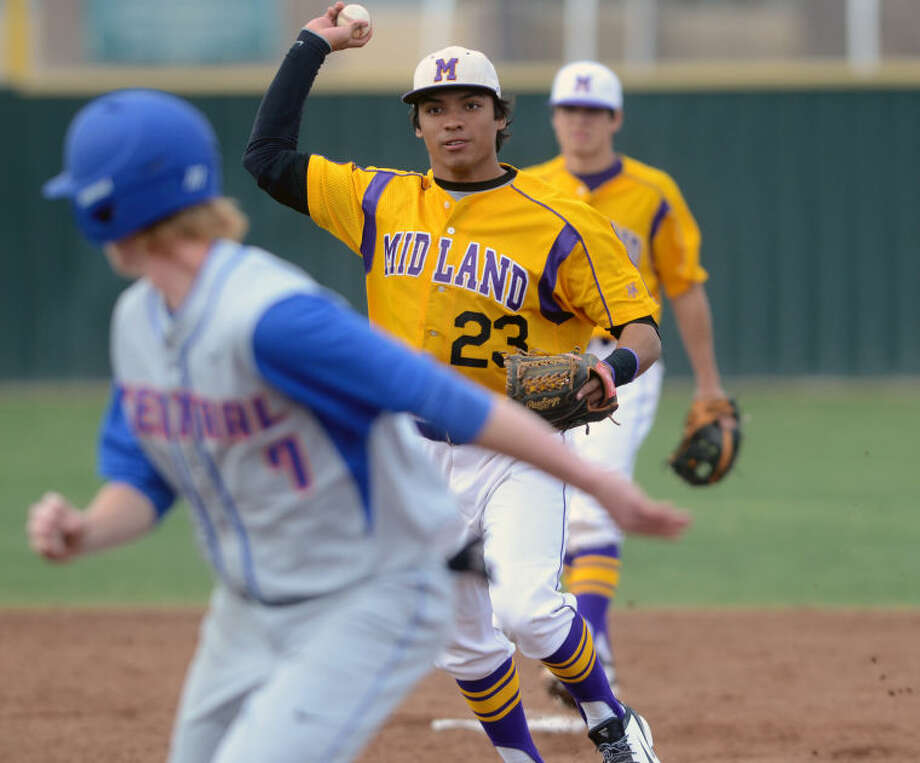 Midland High's Gilbert Sanchez throws to first base over San Angelo Central's trapped baserunner Clay Wegner during the game against San Angelo Central's on Tuesday at Zachery Field. James Durbin/Reporter-Telegram Photo: JAMES DURBIN