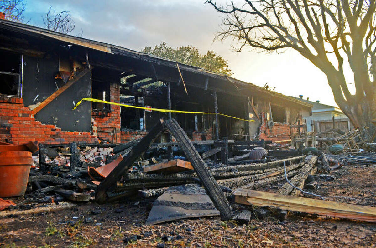 """Exterior view of the remains of Scott Baggett's burned house located on Seaboard Ave. on Wednesday. Baggett says he lost everything in the fire, including his dog Bubba Jack. """"I have great friends and family,"""" said Baggett, """"I will be ok."""" James Durbin/Reporter-Telegram"""