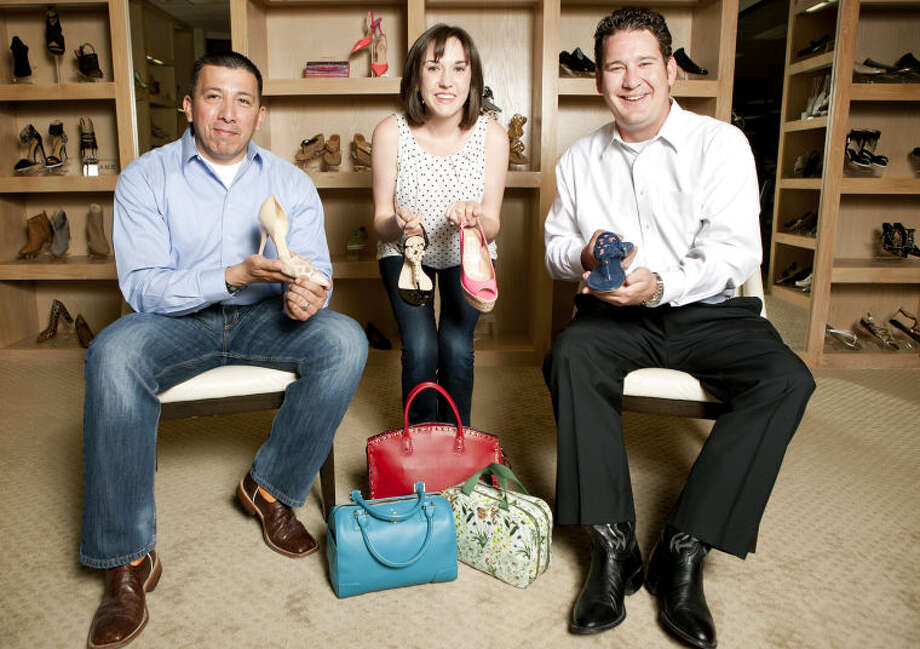 "Event organizer Lauren Blackketter and two of her ""Shoe Guys"" recruits, Chris Fuentes and J. Ross Lacy, pose for the Wine, Women & Shoes event during a photoshoot Friday at Julian Gold's shoe salon. James Durbin/Reporter-Telegram Photo: James Durbin"